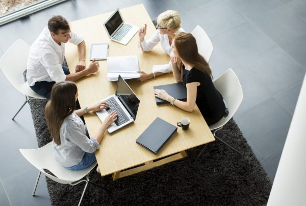 Group of professionals in office, electronic distribution