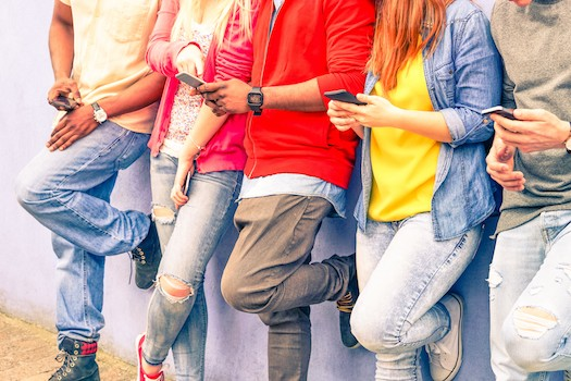 Group of young people using mobile phones